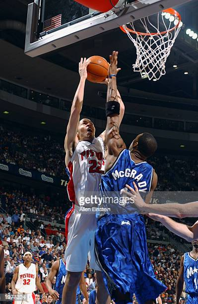 Tayshaun Prince of the Detroit Pistons shoots over Tracy McGrady of the Orlando Magic in Game five of the Eastern Conference Quarterfinals during the...