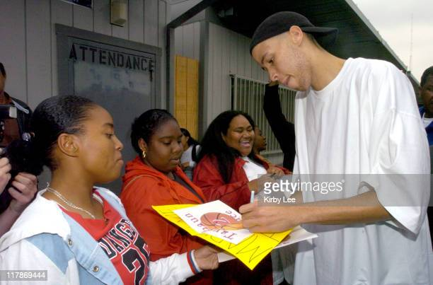 Tayshaun Prince of the Detroit Pistons signs autographs for Dominguez High School students during visit to his alma mater on Monday June 7 2004