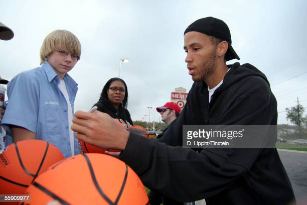 Tayshaun Prince of the Detroit Pistons signs autographs for fans during The Players at the Pump promotion at the Meijer Store October 12 2005 in...