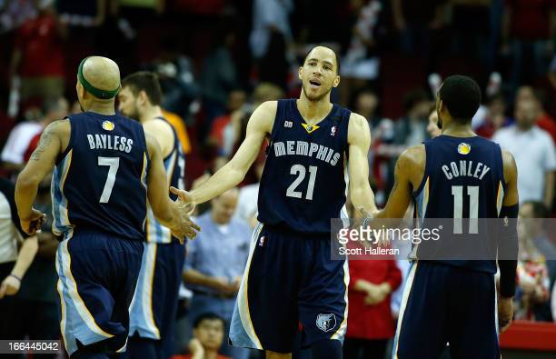 Tayshaun Prince of the Memphis Grizzlies celebrates a free throw with teammates Jerryd Bayless and Mike Conley in fourth quarter during the game...