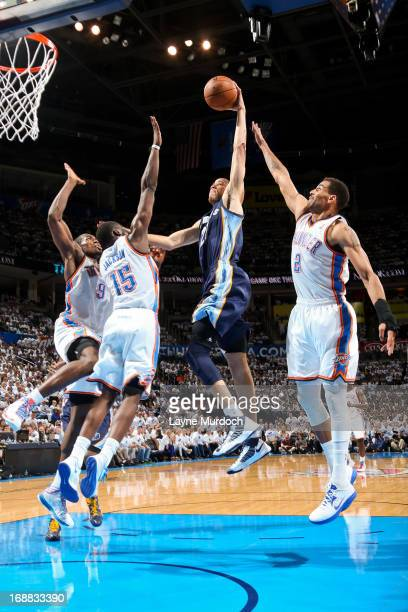 Tayshaun Prince of the Memphis Grizzlies rises for a dunk against Serge Ibaka Reggie Jackson and Thabo Sefolosha of the Oklahoma City Thunder in Game...