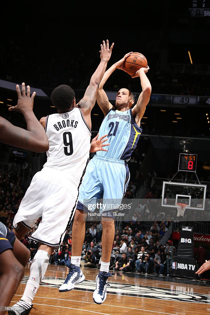 Tayshaun Prince #21 of the Memphis Grizzlies shoots the ball against MarShon Brooks #9 of the Brooklyn Nets on February 24, 2013 at the Barclays Center in the Brooklyn borough of New York City.