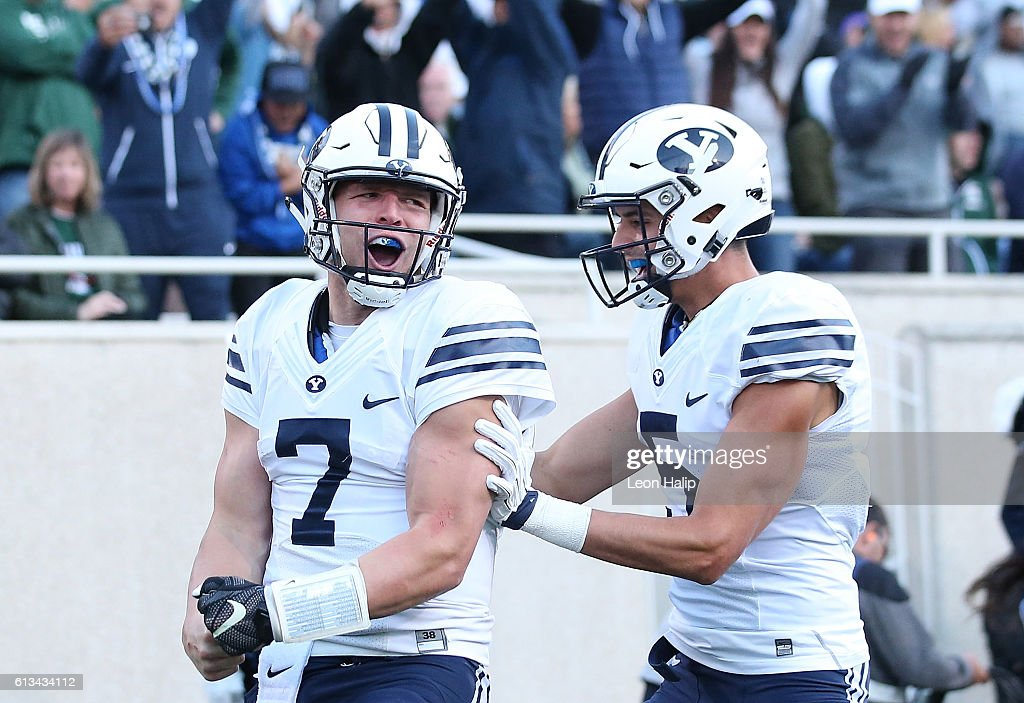 Taysom Hill #7 of the Brigham Young Cougars celebrates a fourth quarter touchdown during the game against the Michigan State Spartans at Spartan Stadium on October 8, 2016 in East Lansing, Michigan.