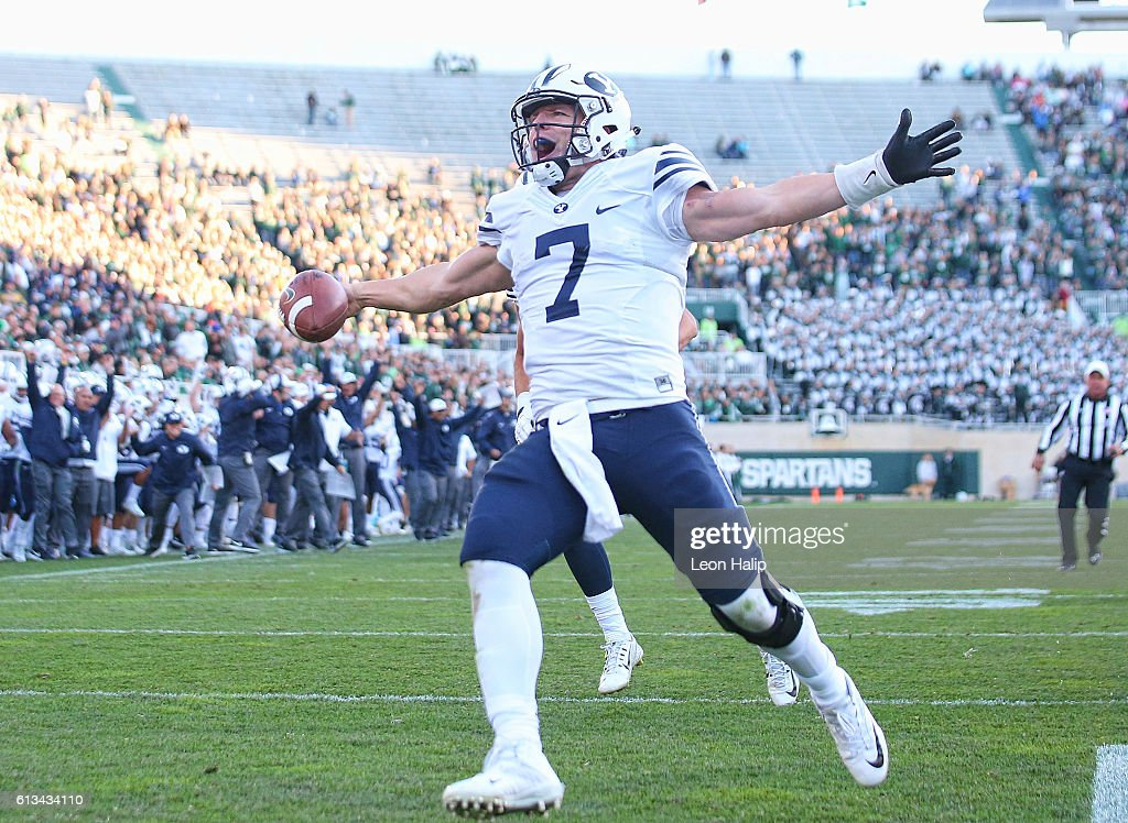 Taysom Hill #7 of the Brigham Young Cougars runs for a fourth quarter touchdown during the game against the Michigan State Spartans at Spartan Stadium on October 8, 2016 in East Lansing, Michigan.