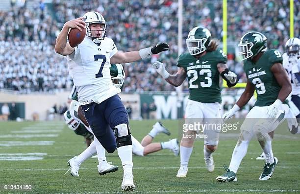 Taysom Hill of the Brigham Young Cougars runs for a fourth quarter touchdown during the game against the Michigan State Spartans at Spartan Stadium...