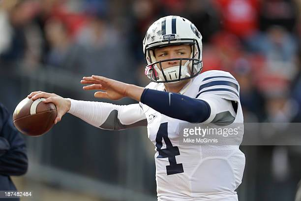 Taysom Hill of the BYU Cougars runs through some pre game drills before the game against the Wisconsin Badgers at Camp Randall Stadium on November 09...