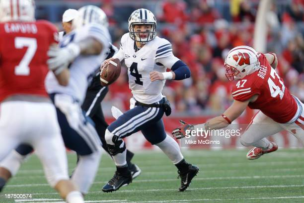 Taysom Hill of the BYU Cougars scrambles out of pocket during the first half of play against the Wisconsin Badgers at Camp Randall Stadium on...