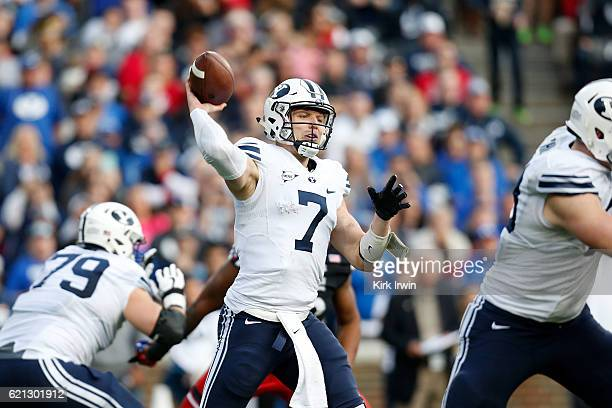 Taysom Hill of the BYU Cougars throws a pass during the third quarter of the game against the Cincinnati Bearcats at Nippert Stadium on November 5...