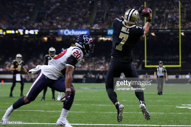 Taysom Hill of the New Orleans Saints catches the ball for a touchdown as Justin Reid of the Houston Texans defends during the second half of a game...