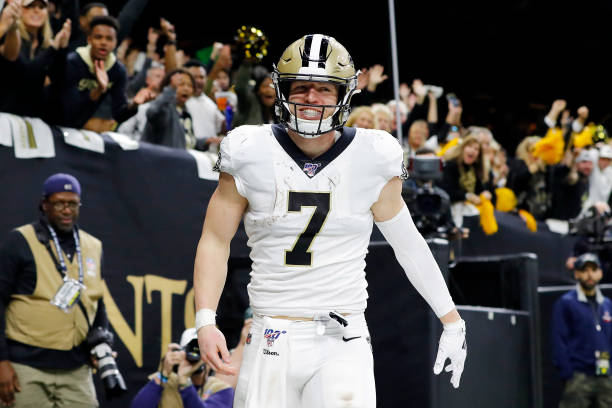 Taysom Hill of the New Orleans Saints celebrates after catching a touchdown pass during the fourth quarter against the Minnesota Vikings in the NFC...
