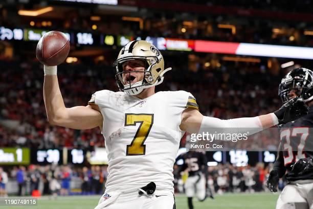 Taysom Hill of the New Orleans Saints celebrates as he scores on a 30yard touchdown run during the second quarter against the Atlanta Falcons at...