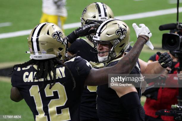 Taysom Hill of the New Orleans Saints celebrates his nine-yard touchdown against the Los Angeles Chargers with Marquez Callaway during their NFL game...
