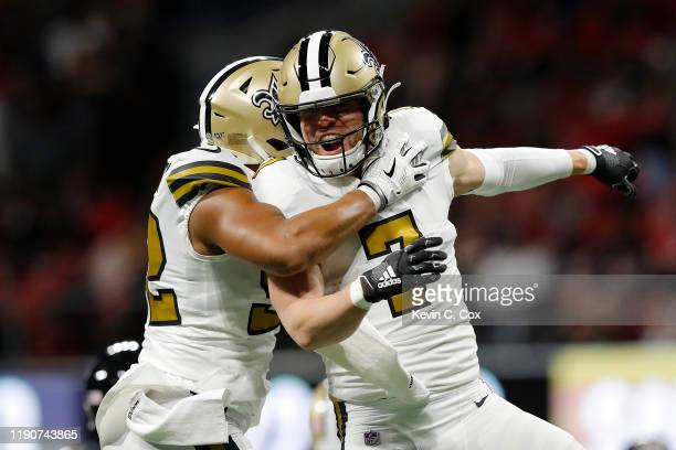 Taysom Hill of the New Orleans Saints celebrates with Craig Robertson after a touchdown against the Atlanta Falcons during the first quarter at...