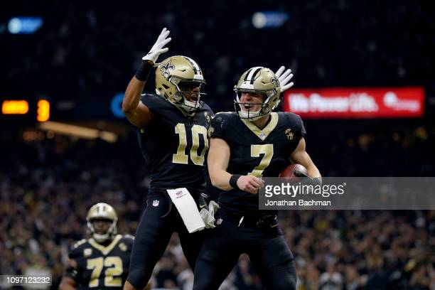 Taysom Hill of the New Orleans Saints celebrates with Tre'Quan Smith after scoring a touchdown against the Los Angeles Rams during the third quarter...