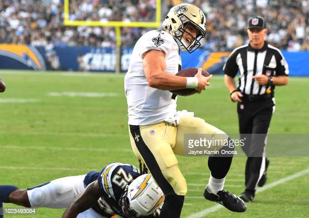 Taysom Hill of the New Orleans Saints gets past Rayshawn Jenkins of the Los Angeles Chargers as he runs into the end zone for a touchdown in the...