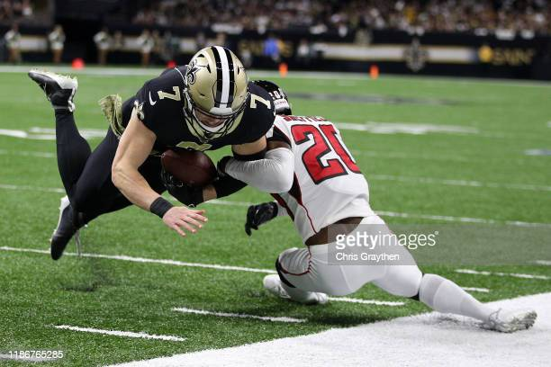 Taysom Hill of the New Orleans Saints is tackled by Kendall Sheffield of the Atlanta Falcons at Mercedes Benz Superdome on November 10 2019 in New...