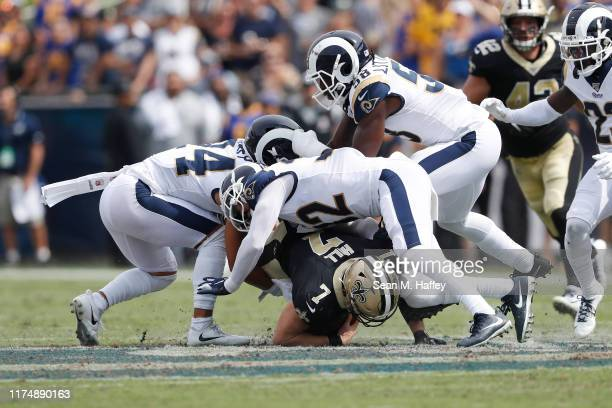 Taysom Hill of the New Orleans Saints is tackled by the Los Angeles Rams defense during the first half in the game at Los Angeles Memorial Coliseum...