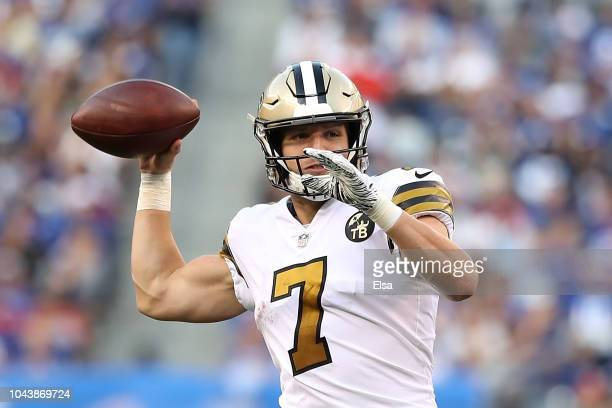 Taysom Hill of the New Orleans Saints makes a throw during the game against the New York Giants at MetLife Stadium on September 30 2018 in East...