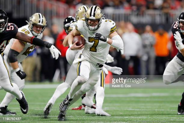 Taysom Hill of the New Orleans Saints runs for a 30yard touchdown against the Atlanta Falcons during the second quarter at MercedesBenz Stadium on...