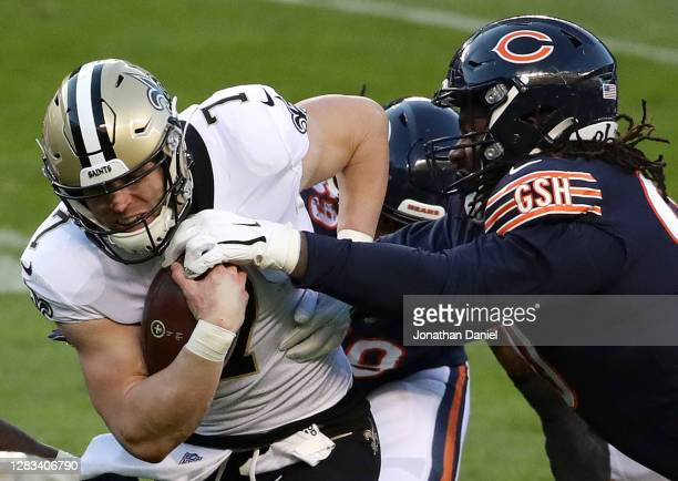 Taysom Hill of the New Orleans Saints runs the ball against John Jenkins of the Chicago Bears in the second quarter at Soldier Field on November 01,...