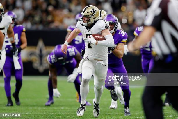 Taysom Hill of the New Orleans Saints runs with the ball during the second half against the Minnesota Vikings in the NFC Wild Card Playoff game at...