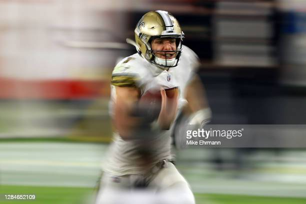 Taysom Hill of the New Orleans Saints runs with the ball during the first half against the Tampa Bay Buccaneers at Raymond James Stadium on November...
