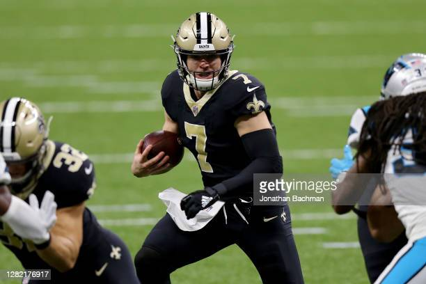 Taysom Hill of the New Orleans Saints runs with the ball in the first quarter against the Carolina Panthers at the Mercedes-Benz Superdome on October...