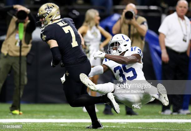 Taysom Hill of the New Orleans Saints rushes for a touchdown over cornerback Pierre Desir of the Indianapolis Colts n the third quarter of the game...