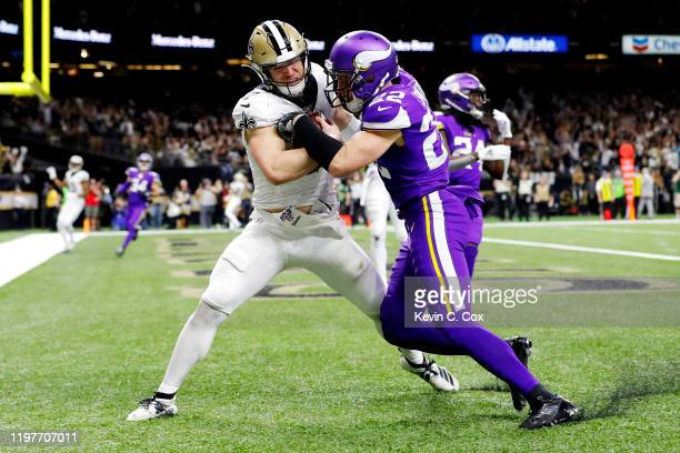 Taysom Hill of the New Orleans Saints scores a 20yard receiving touchdown during the fourth quarter as he is defended by Harrison Smith of the...