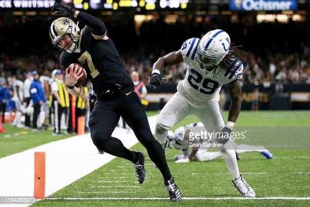 Taysom Hill of the New Orleans Saints scores a touchdown over free safety Malik Hooker of the Indianapolis Colts in the third quarter of the game at...