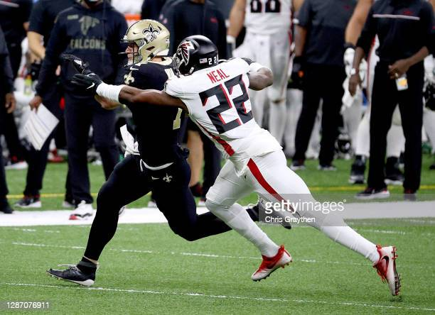 Taysom Hill of the New Orleans Saints scrambles as Keanu Neal of the Atlanta Falcons makes the tackle in the first quarter at Mercedes-Benz Superdome...