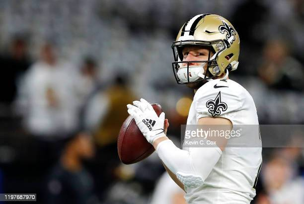Taysom Hill of the New Orleans Saints warms up before the NFC Wild Card Playoff game against the Minnesota Vikings at Mercedes Benz Superdome on...