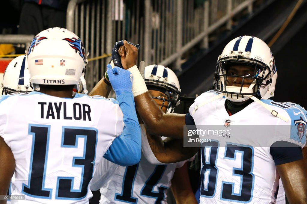 Taywan Taylor #13 and Harry Douglas #83 of the Tennessee Titans react before the AFC Divisional Playoff game against the Tennessee Titans at Gillette Stadium on January 13, 2018 in Foxborough, Massachusetts.