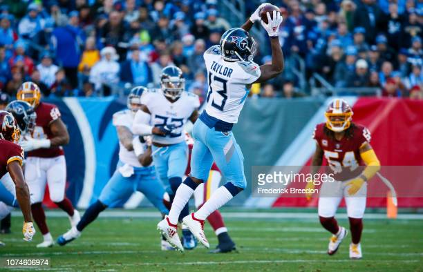 Taywan Taylor of the Tennessee Titans catches a pass from Marcus Mariota during the first quarter against the Washington Redskins at Nissan Stadium...