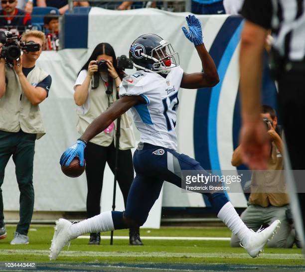 Taywan Taylor of the Tennessee Titans struts into the endzone as he scores a touchdown against the Houston Texans during the first half at Nissan...