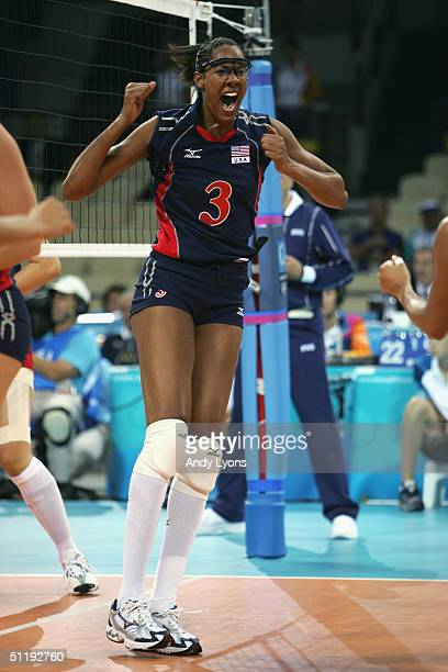 Tayyiba Haneef of the United States celebrates in the women's indoor Volleyball preliminary match against China on August 14 2004 during the Athens...