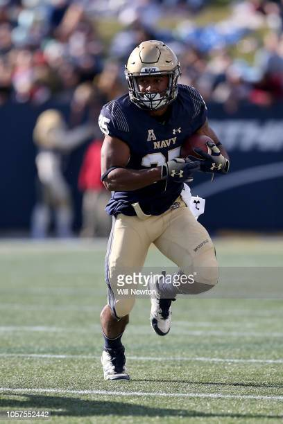 Tazh Maloy of the Navy Midshipmen runs against the Houston Cougars during the first half at NavyMarines Memorial Stadium on October 20 2018 in...