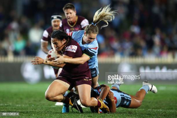 Tazmin Gray of the Maroons is tackled by Kezie Apps of the Blues during the Women's State of Origin match between New South Wales and Queensland at...