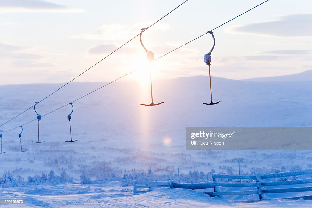 T-bars of ski lift hanging over snowy hill : Stock Photo