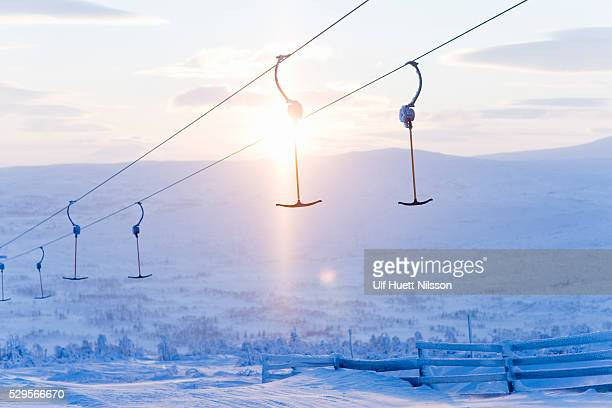 T-bars of ski lift hanging over snowy hill