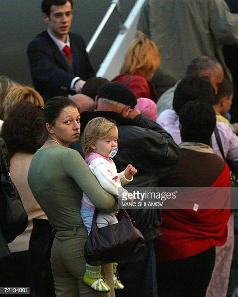 People board a Russian airplane to leave Georgia for Russia at Tbilisi airport 10 October 2006 Russia was set to expel 119 citizens of neighboring...