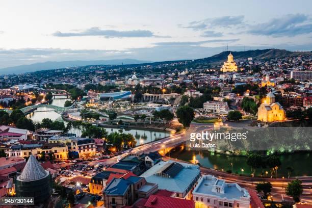 Tbilisi overview illuminated at dusk.