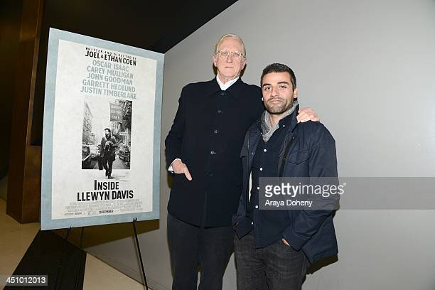 Bone Burnett and Oscar Isaac attend a screening and Q A of 'Inside Llewyn Davis' at the Landmark Theater on November 20 2013 in Los Angeles California