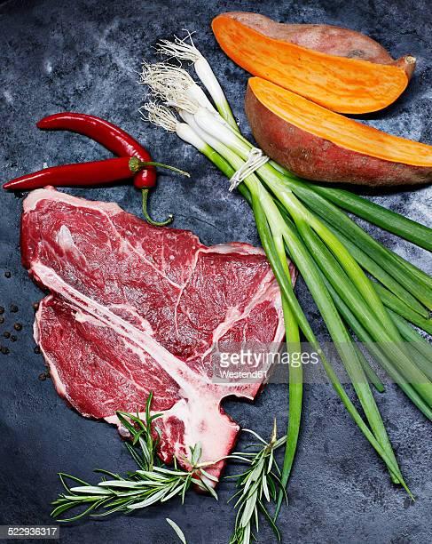 T-Bone Steak, sweet potatoes, spring onions, red chili and rosemary