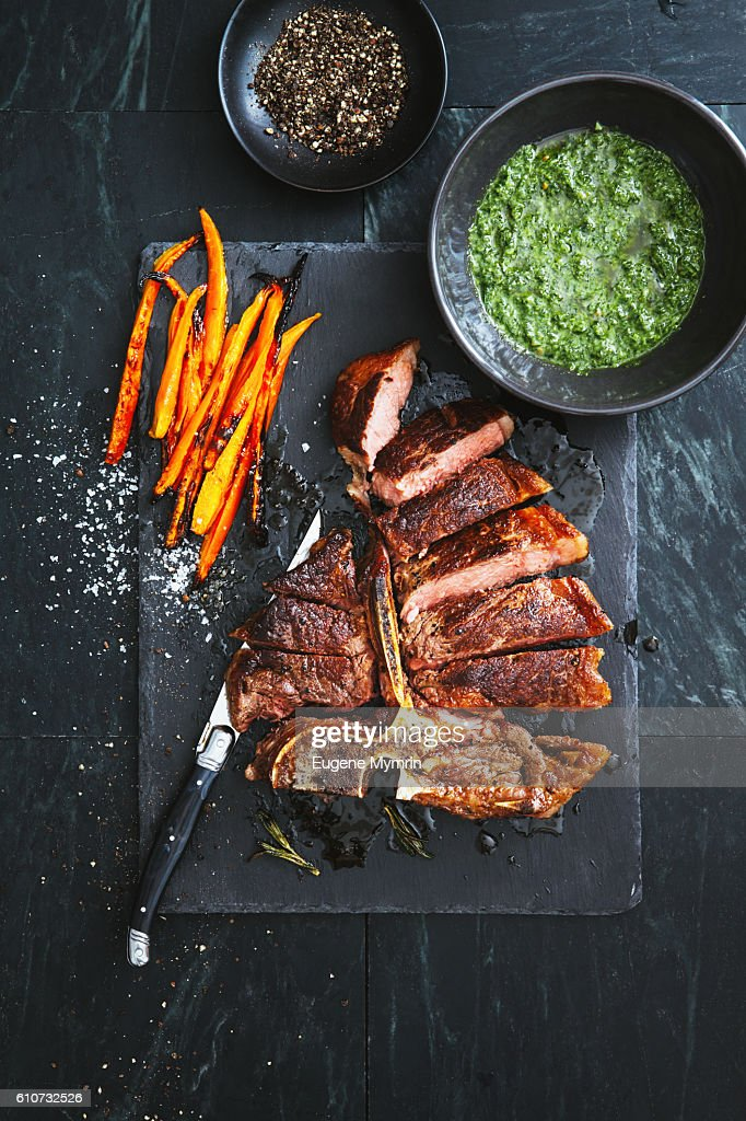 T-bone steak with herbs and vegetables : Stock Photo