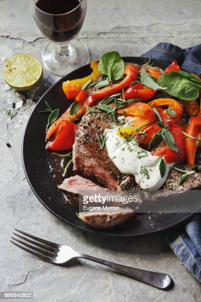 t-bone steak with herbs and vegetables - roasted pepper stock photos and pictures