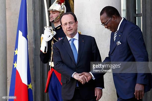 Tchad's President Idriss Deby is escorted by French president Francois Hollande as he leaves the African security summit on May 17 at the Elysee...