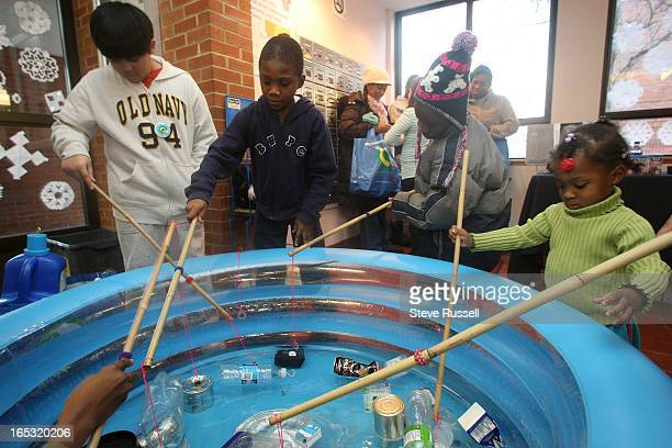 TCHC12/17/07Children fish for recyclables at the launch and information night at the Toronto Community Housing Corp at Lambertlodge Ave The TCHC has...
