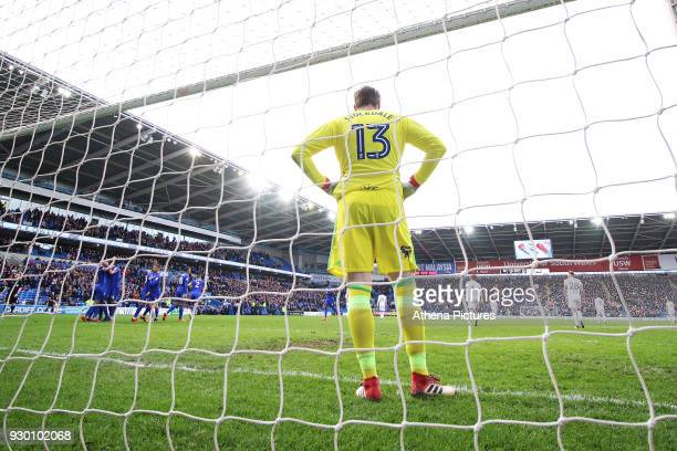 tDavid Stockdale of Birmingham City looks dejected as Callum Paterson of Cardiff City celebrates scoring his sides third goal of the match during he...