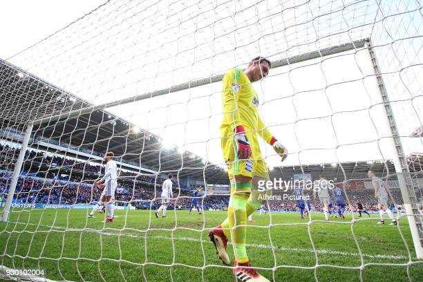 tDavid Stockdale of Birmingham City looks dejected as Craig Bryson of Cardiff City celebrates scoring his sides second goal of the match during he...